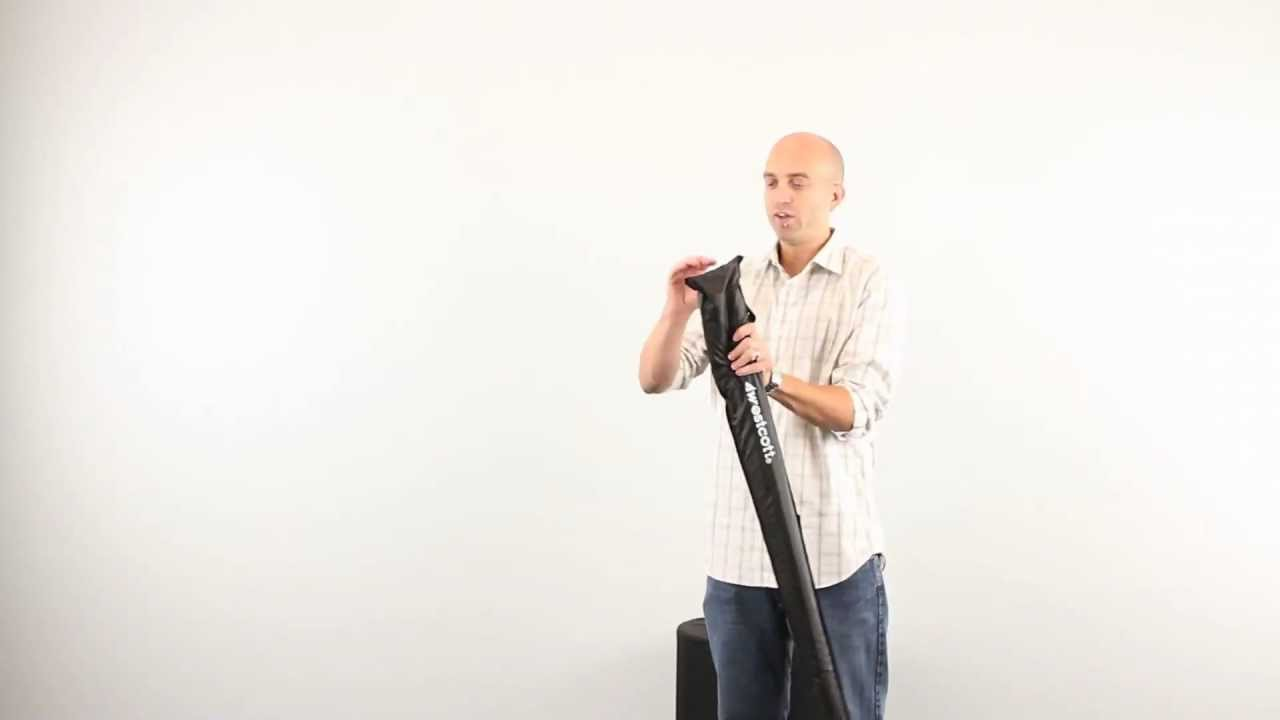 Placing a 7′ Parabolic Umbrella in its Carry Case