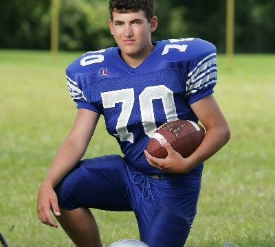 Outdoor Football Portrait using a Scrim Jim